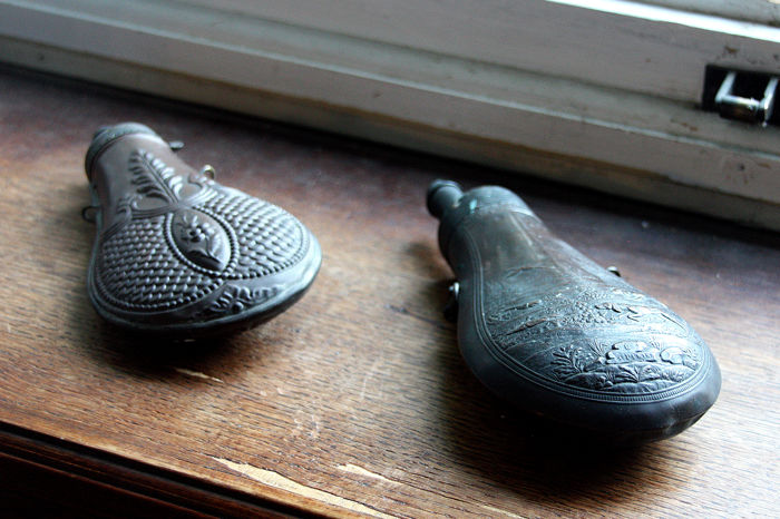 Two black powder flask, possibly English, end 1700s
