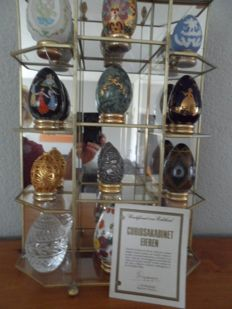 Franklin Mint Treasury of Egg collection with glass display and certificate.