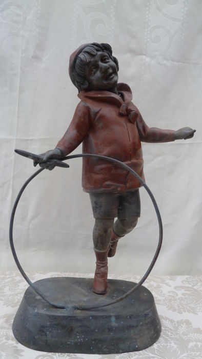 Large sculpture of child with hoop - presumably made of zamak/régule - France - late 19th century