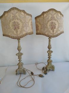 A pair of gilt walnut candlesticks later modified into two table lamps, with original and precious fabric shades - 20th century