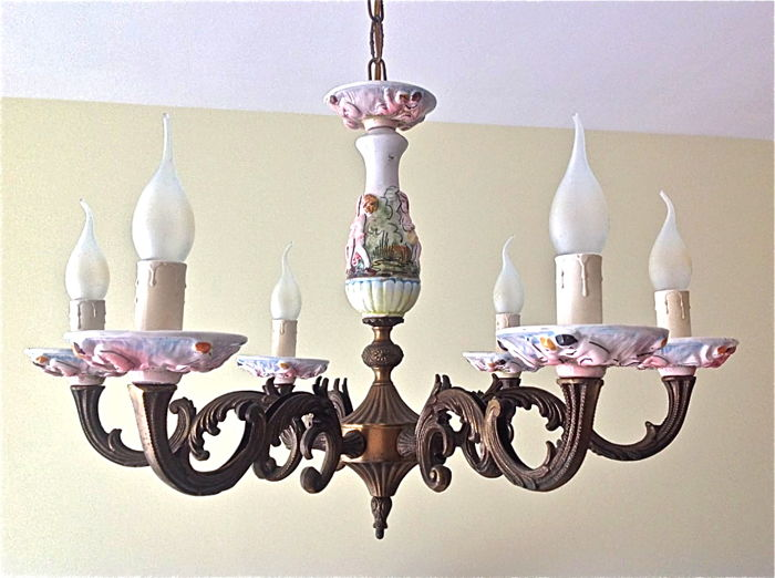 Six-armed bronze chandelier with porcelain vase and saucers
