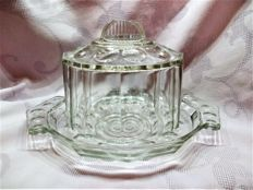 An Art Deco bell jar of pressed glass