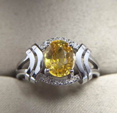 Yellow sapphire, diamond, 18K gold ring. Gem weight: 1.46ct. Gems have NCTC certificates.New, no wear. * no reserve price *