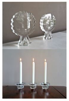 A set of design cut Swedish glass candlesticks and a set of crystal candlesticks