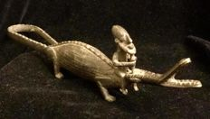 Mali , Dogon Culture ( West Africa ) , bronze group,  native riding a crocodile , unknown date