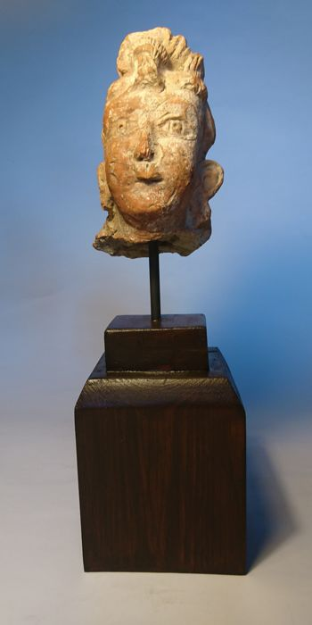 Head of Buddhist Deity/Buddha - Stucco on Wood Mount - 41x13 cms total size