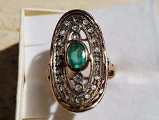 Large oval ring with emerald and diamonds