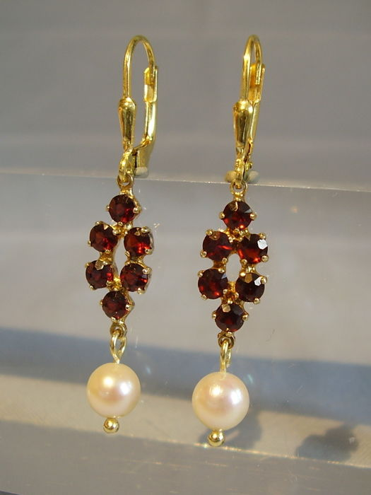 Earrings with faceted garnets and white Akoya pearls in antique design