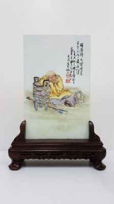A porcelain plate with hard wooden stand, replica - China - late 20th century