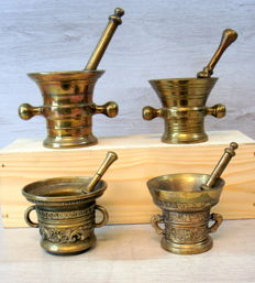 Four antique bronze mortars