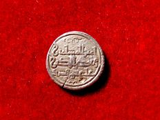 Al-Andalus - Almoravid rule (1086 – 1147), silver quirat 0.99 g. 12 mm, coined in the name of the emir Ali ben Yusuf and his heir Tasfin (1136 – 1143). Beautiful and rare!