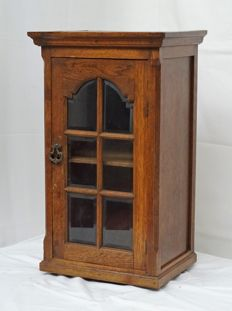 Oak hall cabinet with cut glass in door, first half 20th century