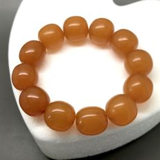 Vintage Amber bracelet in opaque butterscotch colour, ø14-16.4 mm, weight: 27.9 grams, Baltic region, no reserve