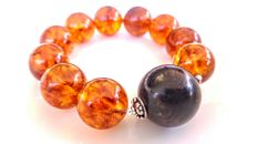 Round beads Baltic Amber modified cognac colour  with Black accent bracelet - 20 mm diameter, 51 gram