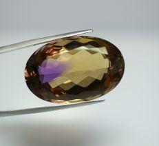 Ametrin bicoloured (violet-brownish-yellow)    46.40 ct