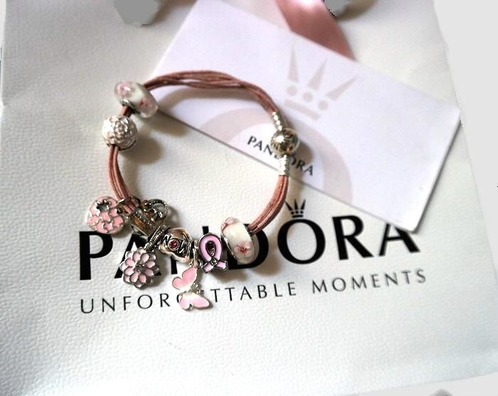 Bracelet (19 cm) in 925 silver with pink Pandora cord and nine charms.