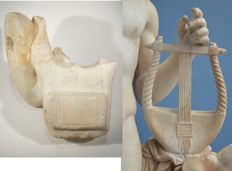 Exciting Roman fragment with part of the arm and a lyre of an Apollo Kitharoidos statue, marble.  H, 19 cm