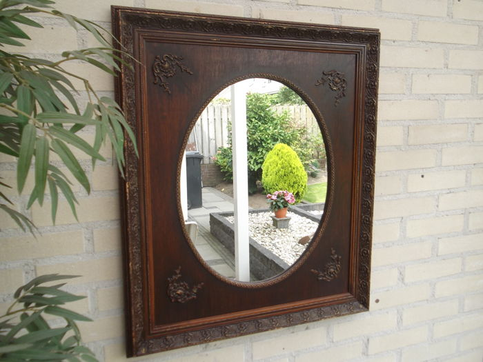 Oval mirror in square oak frame - late 19th century/early 20th century