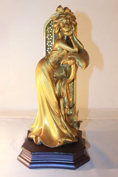 Sculpture of a woman in gold dust - Second half of the 20th century