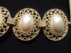 "Christian Dior - eyecatching bracelet consisting of 4 medal links with oval ""pearls"""