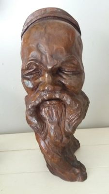A bust of an old Chinese man