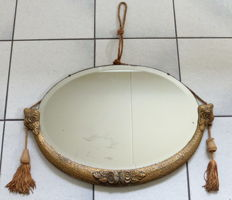 Antique wood gold-plated oval mirror with facet edge and ornaments of roses