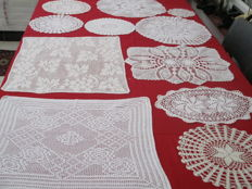 Lot of nine white cotton crochet table doilies.