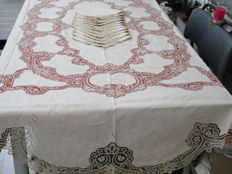 Lush embroidered and bobbin laced tablecloth with 12 napkins.