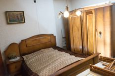 Five-piece bedroom furniture: consisting of a double bed, a pair of night cabinets, four-door linen closet, dresser with mirror - Belgium - 1st half 20th century