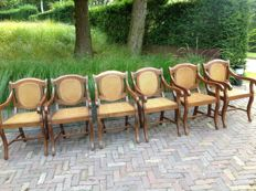 Set of six wooden dining room chairs with wicker, comes with six seat cushions with diamond/floral pattern - Colonial style - 20th century