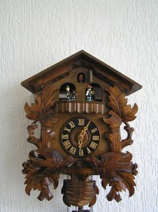 Large wooden cuckoo clock with music box and mechanisms – 2nd half 20th century