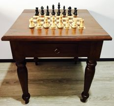 Teak chess table with Club London weighted pieces