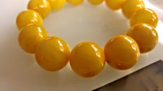 Egg yolk colour modified Baltic Amber Bracelet , hole ca. 54 mm, 42 grams
