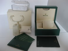 Rolex set:  Green box with wave motif, model 39137.02, new condition, raised watch holder and padded display cushion with logo, with instruction booklets and warranty manual, padded plastic watch holder