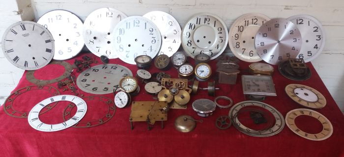 Clock parts - Dials, spring barrels and small movements and other parts