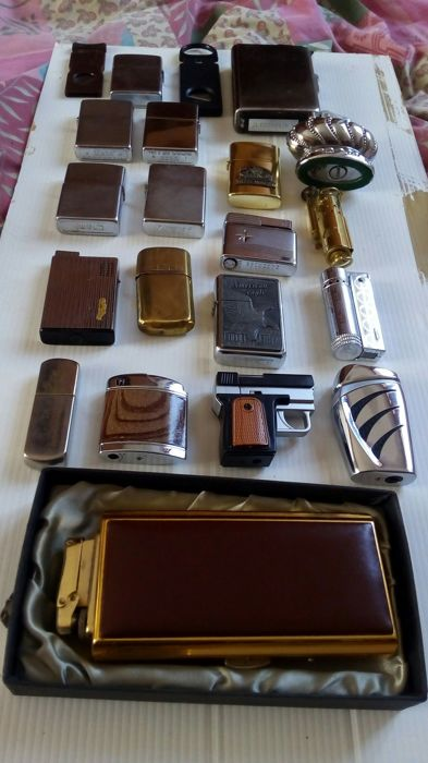 19 lighters, various types, shapes, and years, 2 cigar cutters
