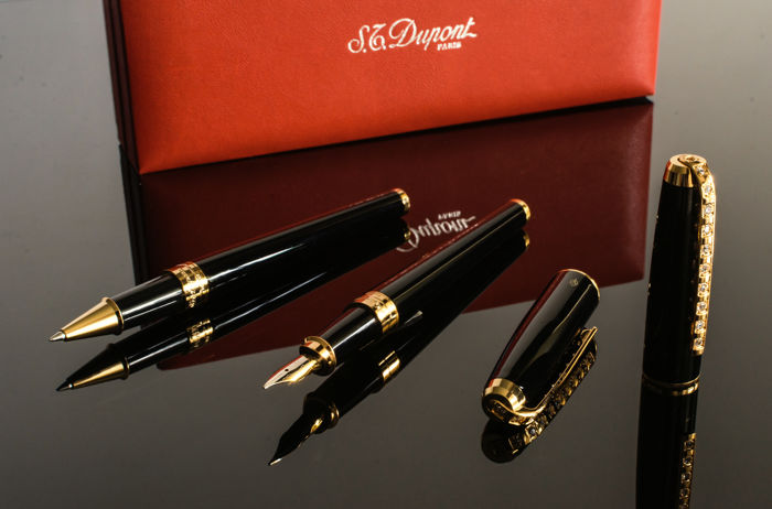 S.T. Dupont Olympio pen set, rarity, special edition: Filler & ballpoint pen in black paint - gold with 11 diamonds each at the clip