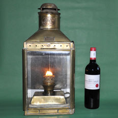 A very large brass ship lamp with oil burner