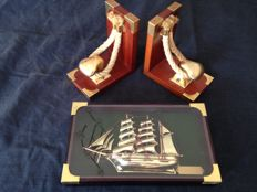 Corvette artwork, 1860 in brass, and Noray bookends