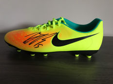 Raphaël Varane autographed Nike football shoe with photo evidence and certificate of authenticity