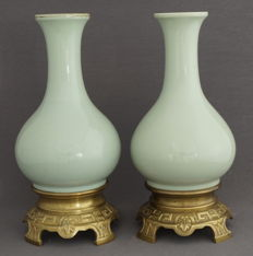 A set of celadon ornamental vases on gilded bronze bases - France - 20th century