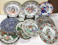 9 porcelain plates with brand underneath the base - China - Second half of the 20th century