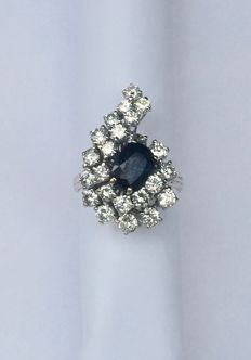 18 kt white gold ring with diamonds and sapphires in shape of 9 or six depending how it is worn