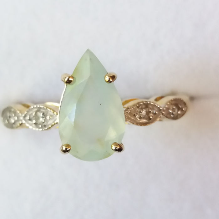1965s design Natural 0.91ct Brazilian Opal in Paraiba colour with Madagascan White Sapphires in 9k yellow gold.