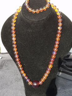 Blue Sumatra Amber fluorescent beaded necklace and bracelet, untreated, weight 84.1 grams
