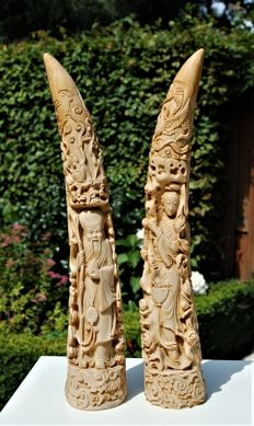 Two special ivorine statues with images