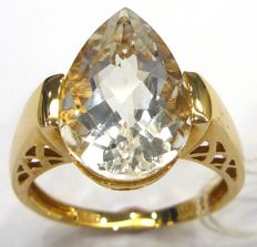 A 14 KT yellow gold ring with pear cut white Topaz