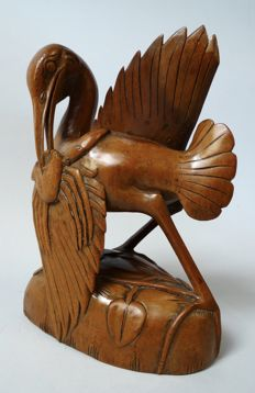 Woodcarving bird eating a crab – Bali – Indonesia - mid 20th century