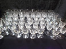 A set of 41 pieces of sheared crystal glasses, cut in different shapes, wine glasses and liqueur. France.