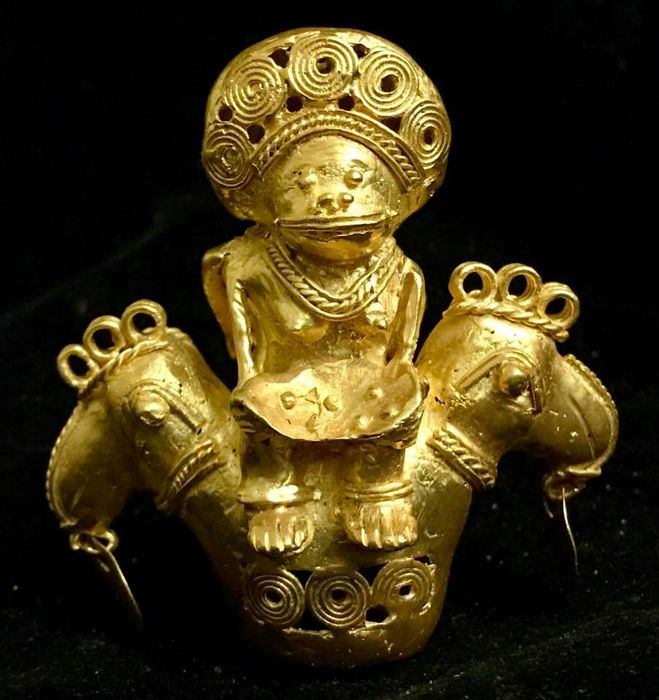 A fabulous and very rare, double sided, anthropomorphic and zoomorphic, Tumbaga Gold artefact, Colombian, Tairona Culture, 98 x 92 x 57 mm, 120.61 grams, a ritual amulet, offering priest and priestess riding a couple of paradise birds